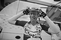 Tour of Belgium 2013.stage 3: iTT..putting on a TT-helmet is not an easy job as demostrated by Marcel Sieberg (DEU)