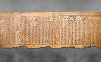 "Ancient Egyptian Book of the Dead papyrus - Spell 105 for gratifying the deceased with Ka, Iufankh's Book of the Dead, Ptolemaic period (332-30BC).Turin Egyptian Museum. Grey Background<br /> <br /> The spell is "" Hail to thee, my spirit, my lifetime. Behold I am come unto thee risen, powerful, posessed of a soul, mighty.<br /> <br /> You who weighs in the balance. may truth rise to the nose of Ra, on that day of judgement, ley not my head be taken away from me.""<br /> <br /> The translation of  Iuefankh's Book of the Dead papyrus by Richard Lepsius marked a truning point in the studies of ancient Egyptian funereal studies."