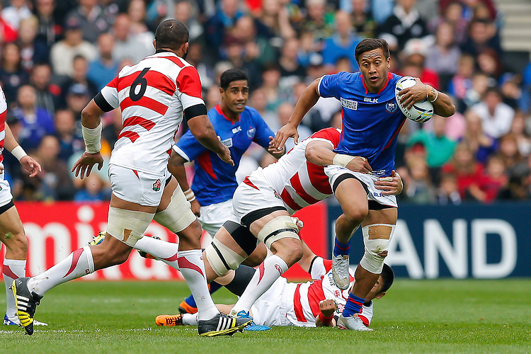 Samoa Full Back Tim Nanai-Williams is tackled by Japan Lock Luke Thompson - Mandatory byline: Rogan Thomson - 03/10/2015 - RUGBY UNION - Stadium:mk - Milton Keynes, England - Samoa v Japan - Rugby World Cup 2015 Pool B.