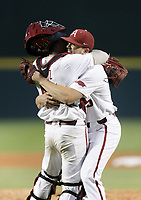 Arkansas catcher Casey Opitz (12) and Kevin Kopps (45) embrace following their win, Monday, June 7, 2021 in the ninth inning of the NCAA Fayetteville Regional at Baum-Walker Stadium in Fayetteville. Check out nwaonline.com/210608Daily/ for today's photo gallery. <br /> (NWA Democrat-Gazette/Charlie Kaijo)