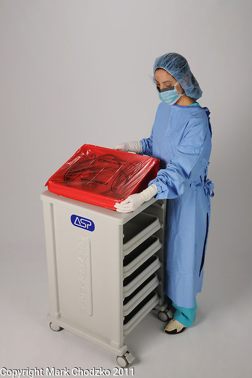 Healthcare professional with mediacal sterilization products