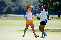 5th September 2021; Toledo, Ohio, USA;  Danielle Kang of Team USA and Georgia Hall of Team Europe greet each other on the 18th green at the conclusion of the morning Four-Ball competition during the Solheim Cup on September 5th