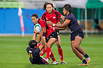 Thailand plays Singapore during the17th Asian Games 2014 Rugby Womens Sevens tournament on October 02, 2014 at the Namdong Asiad Rugby Field in Incheon, South Korea. Photo by Alan Siu / Power Sport Images
