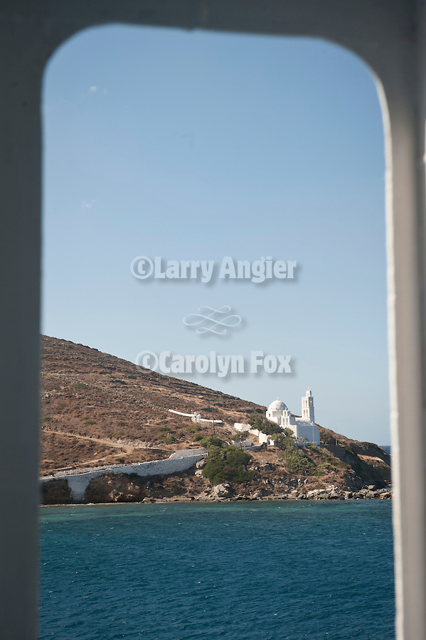 White Orthodox chapel by the mouth of the port from on the NEL Lines Aqua Jewel at the port on the Isle of Ios, Greece
