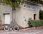 The Silver Man's bike awaits his evening performance outside the Waterfront Playhouse in Duval Square, Key West, Florida, USA.