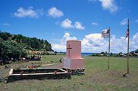 Two flags of USA and Vanuatu near a grave in Sulphur Bay Village, Ipekel Ipeukel, Tanna Island, Vanuatu.
