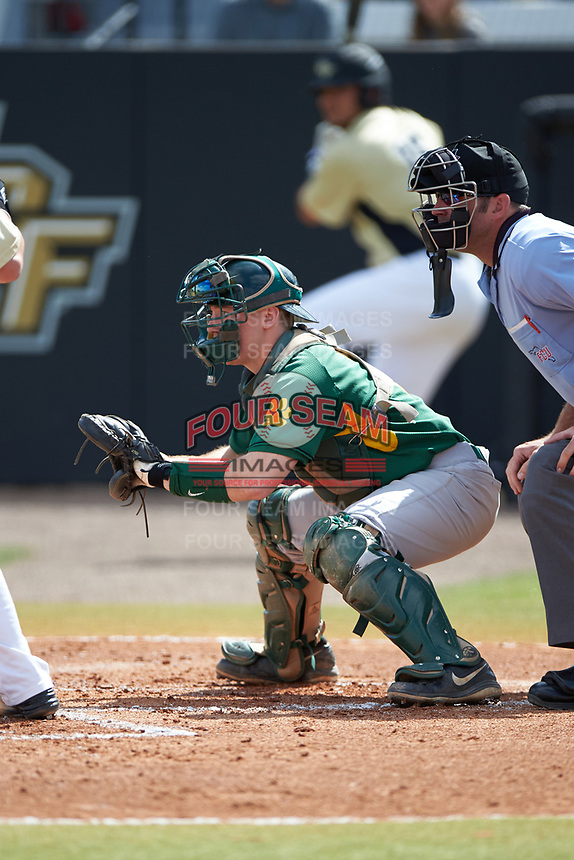 Siena Saints catcher Phil Madonna (3) and umpire Travis Carlson await the pitch during a game against the UCF Knights on February 21, 2016 at Jay Bergman Field in Orlando, Florida.  UCF defeated Siena 11-2.  (Mike Janes/Four Seam Images)