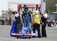 Sept. 30, 2012; Madison, IL, USA: NHRA Safety Safari members help top fuel dragster driver T.J. Zizzo during the Midwest Nationals at Gateway Motorsports Park. Mandatory Credit: Mark J. Rebilas-