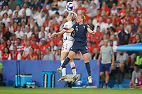 PARIS, FRANCE - JUNE 28: Megan Rapinoe #15, Marion Torrent #4 during a 2019 FIFA Women's World Cup France quarter-final match between France and the United States at Parc des Princes on June 28, 2019 in Paris, France.