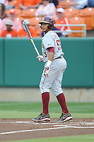 Florida State Seminoles third baseman Jose Brizuela #53 swings at a pitch during a game against the Clemson Tigers at Doug Kingsmore Stadium on March 22, 2014 in Clemson, South Carolina. The Seminoles defeated the Tigers 4-3. (Tony Farlow/Four Seam Images)