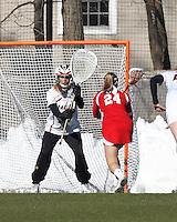 Boston College goalkeeper Emily Mata (33) awaits Boston University midfielder Sofia Robins (24) from free position..Boston College (white) defeated Boston University (red), 12-9, on the Newton Campus Lacrosse Field at Boston College, on March 20, 2013.