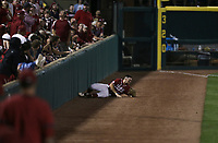 Arkansas outfielder Braydon Webb (8) tries to catch a foul ball, Saturday, June 5, 2021 during the ninth inning in the second game of the NCAA Fayetteville Regional at Baum-Walker Stadium in Fayetteville. Check out nwaonline.com/210606Daily/ for today's photo gallery. <br /> (NWA Democrat-Gazette/Charlie Kaijo)