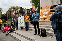 """John Hunter (Member of Divest London).<br /> <br /> London, 29/04/2017. Today, """"Campaign Against Climate Change"""" held a demonstration started at Old Palace Yard and ended on Westminster Bridge, where people formed a human chain showing the message: """"Trump & May Climate Disaster"""". The demonstration was in support and solidarity with the People's Climate March in the US (and over 350 other marches taking place across the globe) and to warn the British Prime Minister Theresa May to stop following Donald Trump """"down the path to climate disaster"""".<br />   <br /> For more information please click here: https://www.facebook.com/events/747422225425039/ & (Video) https://www.facebook.com/campaigncc/videos/1300562783385237/ & (Press Release) http://www.campaigncc.org/node/1782"""
