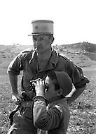 Ecole Militaire d'Infanterie de Cherchell, Algérie, August 1960. Instructor Lieutenant Meniole D'Hauthuile with a farmer's kid.
