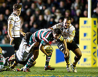 Photo: Richard Lane/Richard Lane Photography. Leicester Tigers v London Wasps. Aviva Premiership. 07/01/2012. Tigers' Ben Youngs is tackled by Wasps' Elliot Daly and Tinus Du Plessis.