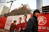 CHINA. Shanghai. Advertisements outside a construction site. Shanghai is a sprawling metropolis or 15 million people situated in south-east China. It is regarded as the country's showcase in development and modernity in modern China. This rapid development and modernization, never seen before on such a scale has however spawned countless environmental and social problems. 2008