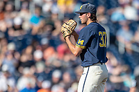 Michigan Wolverines pitcher Karl Kauffmann (37) looks to his catcher for the sign against the Vanderbilt Commodores during Game 3 of the NCAA College World Series Finals on June 26, 2019 at TD Ameritrade Park in Omaha, Nebraska. Vanderbilt defeated Michigan 8-2 to win the National Championship. (Andrew Woolley/Four Seam Images)