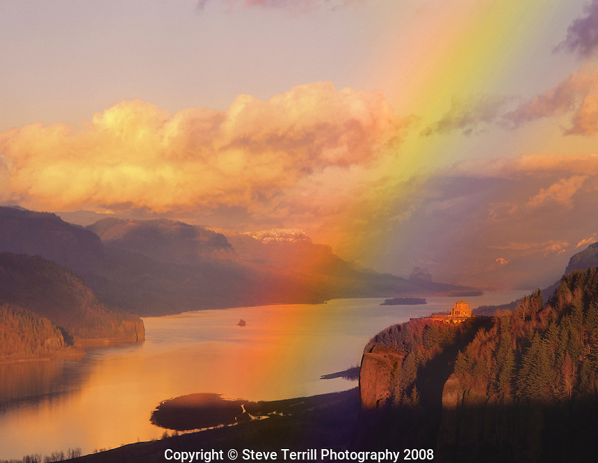Evening light creates rainbow over Vista House in the Columbia River Gorge National Scenic Area, Oregon