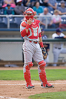 Spokane Indians catcher Joe Maloney #15 looks into the dugout during a game against the Everett AquaSox at Everett Memorial Stadium on June 20, 2012 in Everett, WA.  Everett defeated Spokane 9-8 in 13 innings.  (Ronnie Allen/Four Seam Images)