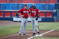 Carolina Mudcats manager Joe Ayrault (33) stands next to Joe Gray Jr. (5) at third base during the game against the Kannapolis Cannon Ballers at Atrium Health Ballpark on June 10, 2021 in Kannapolis, North Carolina. (Brian Westerholt/Four Seam Images)