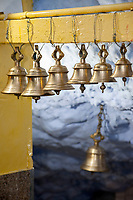 India, Dehradun.  Temple Bells, Tapkeshwar Hindu Temple.