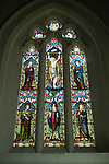 Stained glass window above alter depicting Saint Swithun ( centre) on either side St Peter and St Paul. St Swithuns Church, Headbourne Worthy Hampshire Uk Particially Saxon and earlier. 2012 2010s