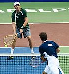 Bob Bryan volleys back a ball from Jordan Kerr at the Freedoms vs. Explorers WTT match in Villanova, PA on July 16, 2012