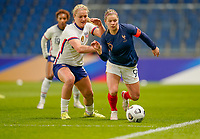 LE HAVRE, FRANCE - APRIL 13: Lindsey Horan #9 of the United States applying the heat to Eugénie le Sommer #9 of France during a game between France and USWNT at Stade Oceane on April 13, 2021 in Le Havre, France.