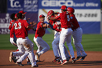 Auburn Doubledays players including Jake Jefferies (23), Melvin Rodriguez (16), Kelvin Gutierrez (5) mob Diomedes Eusebio (31) after a walk off base hit during a game against the Batavia Muckdogs on September 7, 2015 at Falcon Park in Auburn, New York.  Auburn defeated Batavia 11-10 in ten innings.  (Mike Janes/Four Seam Images)