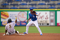 Dunedin Blue Jays shortstop Orelvis Martinez (11) awaits a throw as Norkis Marcos (3) slides into second base during a game against the Bradenton Marauders on May 13, 2021 at BayCare Ballpark in Clearwater, Florida.  (Mike Janes/Four Seam Images)
