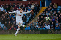 BIRMINGHAM, ENGLAND - MARCH 21: Gylfi Sigurosson of Swansea City  strikes the ball  during the Barclays Premier League match between Aston Villa and Swansea City at Villa Park on March 21, 2015 in Birmingham, England. (Photo by Athena Pictures/Getty Images)