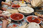 Many hands make tamales at a family Tamalada (tamale making party), Torrance, CA