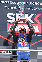 Toprak Razgatlioglu holds up trophy after winning race 1 during the 2021 UK Round of the MOTUL FIM Superbike World Championship (WSB) at Donington Park GP Race Circuit, Donington Park GP, England on the 2-4 July 2021. Photo by Ian Hopgood.