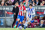Filipe Luis (l) of Atletico de Madrid fights for the ball with Aritz Elustondo of Real Sociedad during their La Liga match between Atletico de Madrid vs Real Sociedad at the Vicente Calderon Stadium on 04 April 2017 in Madrid, Spain. Photo by Diego Gonzalez Souto / Power Sport Images