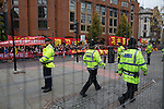 © Joel Goodman - 07973 332324 . 23/10/2015 . Manchester , UK . A large police presence marshals crowds in Albert Square outside Manchester Town Hall waiting for Chinese president , Xi Jinping , who is visiting Manchester as part of his state visit to the United Kingdom . Photo credit : Joel Goodman
