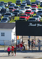 Jul 12, 2020; Clermont, Indiana, USA; NHRA fans wear face masks as they enter the spectator entrance for the E3 Spark Plugs Nationals at Lucas Oil Raceway. This is the first race back for NHRA since the start of the COVID-19 global pandemic. Mandatory Credit: Mark J. Rebilas-USA TODAY Sports
