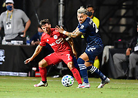 LAKE BUENA VISTA, FL - JULY 26: Pablo Piatti of Toronto FC protects the ball from Ronald Matarrita of New York City FC during a game between New York City FC and Toronto FC at ESPN Wide World of Sports on July 26, 2020 in Lake Buena Vista, Florida.