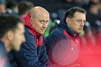 (L-R) Swansea City assistant manager Cameron Toshack and goalkeeping coach Tony Roberts sit in the dugout during the Premier League match between Swansea City and Crystal Palace at The Liberty Stadium, Swansea, Wales, UK. Saturday 23 December 2017