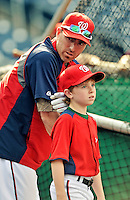 16 May 2012: Washington Nationals first baseman Adam LaRoche's 10-year old son Drake LaRoche listens to his Dad during batting practice prior to a game against the Pittsburgh Pirates at Nationals Park in Washington, DC. Adam notched his 1000th career hit and was named Player of the Game as the Nationals defeated the Pirates 7-4 in the first game of their 2-game series. Mandatory Credit: Ed Wolfstein Photo