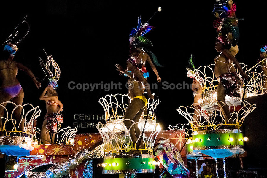 Cuban girls dance on the top of the allegorical float during the fiesta of Carnival, Santiago de Cuba, Cuba, 25 July 2008. Carnival in Santiago de Cuba is a large public celebration which is held - contrary to the other Latin American carnivals - in the summer. The carnival tradition dates back to the 17th century when the Spanish festival of Santiago (St. James) was mixed with street dancing parades of the Black African slaves. Nowadays comparsas, carnival groups of dancers and musicians, flow in the streets and perform popular music like salsa, rumba or reggaeton. In spite of the general lack of funds in Cuba (most of the festival costumes and floats are home-made) the Carnival is very lively and hot show with huge participation of the people of Santiago de Cuba.