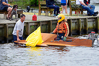 Ryan Runne returns to the pits with a buoy.    (Outboard Hydroplane)