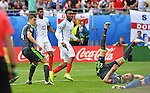 Daniel Sturridge of England scores in the second  half as Chris Gunter of Wales takes a tumble at the Stade Bollaert-Delelis in Lens, France this afternoon during their Euro 2016 Group B fixture.