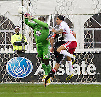 Bill Hamid (28) of D.C. United punches the ball away from Tim Cahill (17) of New York Red Bulls during the game at RFK Stadium in Washington DC. D.C. United tied New York Red Bulls, 1-1.