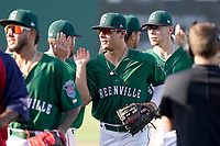 Second baseman Nick Yorke (4) of the Greenville Drive slaps hands with teammates after a win in a game against the Hickory Crawdads on Sunday, August 29, 2021, at Fluor Field at the West End in Greenville, South Carolina. (Tom Priddy/Four Seam Images)
