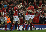 The Welsh players celebrate after Alex Cuthbert scores his second try of the match..2013 RBS 6 Nations Championship.Wales v England.Millennium Stadium.16.03.13.Credit: Steve Pope- Sportingwales
