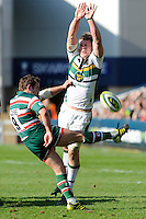 James Grindal of Leicester Tigers sends up a box kick as James Craig of Northampton Saints attempts to bliock during the LV= Cup Final match between Leicester Tigers and Northampton Saints at Sixways Stadium, Worcester on Sunday 18 March 2012 (Photo by Rob Munro, Fotosports International)
