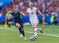 PARIS,  - JUNE 28: Marion Torrent #4 fights for the ball with Megan Rapinoe #15 during a game between France and USWNT at Parc des Princes on June 28, 2019 in Paris, France.