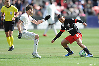 WASHINTON, DC - FEBRUARY 29: Washington, D.C. - February 29, 2020: Edison Flores #10 of D.C. United battles the ball with Drew Moor #3 of the Colorado Rapids. The Colorado Rapids defeated D.C. United 2-1 during their Major League Soccer (MLS)  match at Audi Field during a game between Colorado Rapids and D.C. United at Audi FIeld on February 29, 2020 in Washinton, DC.