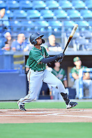 Greensboro Grasshoppers Liover Peguero (10) swings at a pitch during a game against the Asheville Tourists on August 24, 2021 at McCormick Field in Asheville, NC. (Tony Farlow/Four Seam Images)
