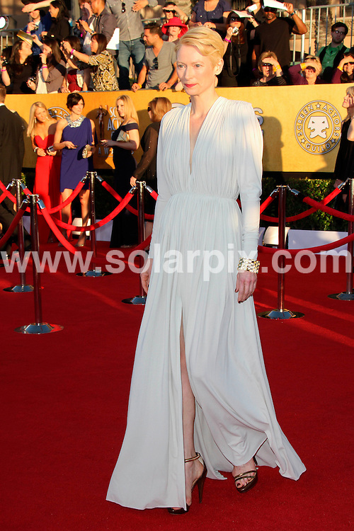 **ALL ROUND PICTURES FROM SOLARPIX.COM**                                             **SYNDICATION RIGHTS FOR UK, AUSTRALIA, DENMARK, PORTUGAL, S. AFRICA, SPAIN & DUBAI (U.A.E) & ASIA (EXCLUDING JAPAN) ONLY**                                                                                  Arrivals for the 18th Annual Screen Actors Guild Awards at the Shrine Auditorium in Los Angeles, CA, USA                                                                This pic:  Tilda Swinton                                                      .JOB REF:   14399    PHZ  Evans    DATE: 29.01.12                                                           **MUST CREDIT SOLARPIX.COM OR DOUBLE FEE WILL BE CHARGED**                                                                      **MUST AGREE FEE BEFORE ONLINE USAGE**                               **CALL US ON: +34 952 811 768 or LOW RATE FROM UK 0844 617 7637**